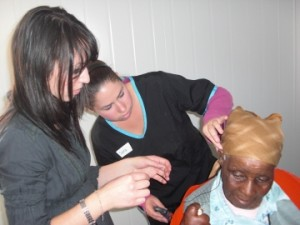 Sara helping one of the Wits students program a hearing aid.